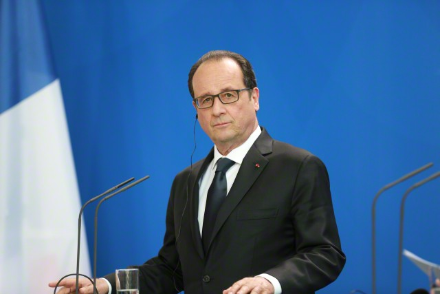 19 May 2015, Berlin, Germany --- Berlin, Germany. 19th May 2015 -- French President Francois Hollande during a joint press conference with German Chancellor Angela Merkel at the Federal Chancellery in Berlin, Germany, 19 May 2015. Image by © Simone Kuhlmey/Demotix/Corbis